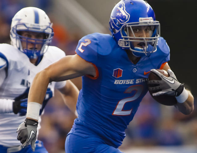 Boise State wide receiver Matt Miller (2) runs the ball in front of an Air Force defender during the first half of an NCAA college football game in Boise, Idaho, Friday, Sept. 13, 2013. (AP Photo/Otto Kitsinger)