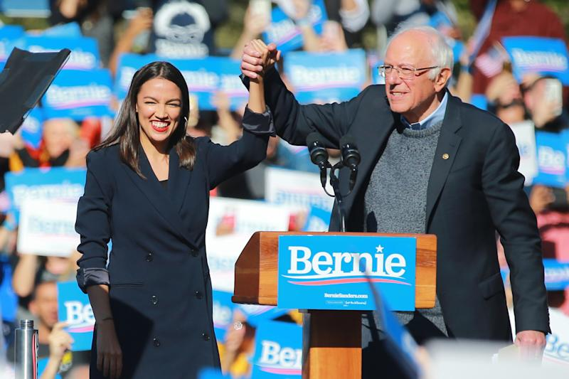 U.S. Representative Alexandria Ocasio-Cortez, Democrat of New York, clasps hands with Vermont senator and Democratic presidential candidate Bernie Sanders at the Bernie's Back Rally in Long Island City, New York on Saturday, Oct. 19, 2019. (Photo: Gordon Donovan/Yahoo News)
