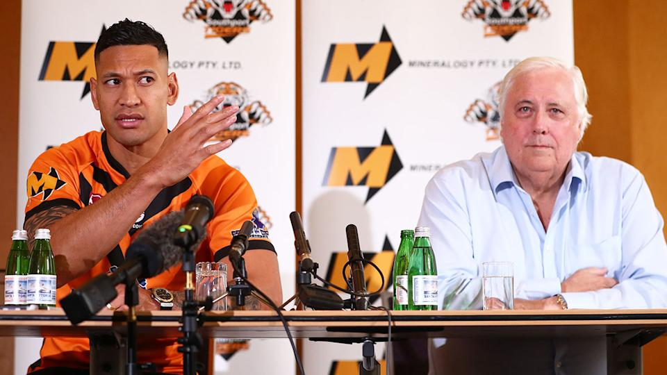 Pictured here, businessman Clive Palmer and Israel Folau address the media in a press conference.