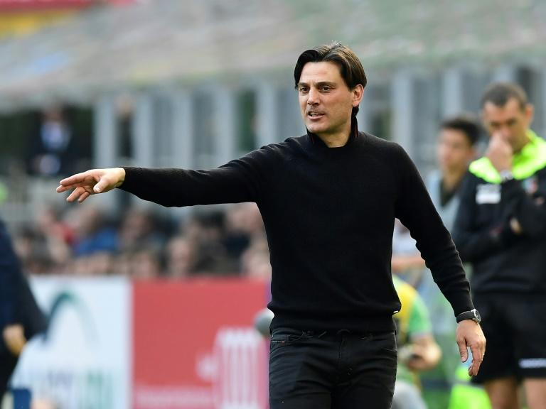 AC Milan's coach Vincenzo Montella follows the action during their Italian Serie A match against Palermo, at the San Siro stadium in Milan, on April 9, 2017