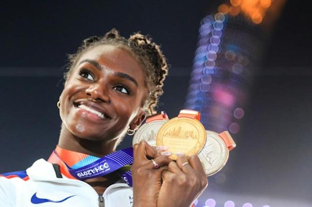 Britain's Dina Asher-Smith poses with her gold medal after winning the 200m at the 2019 world championships (AFP Photo/MUSTAFA ABUMUNES)