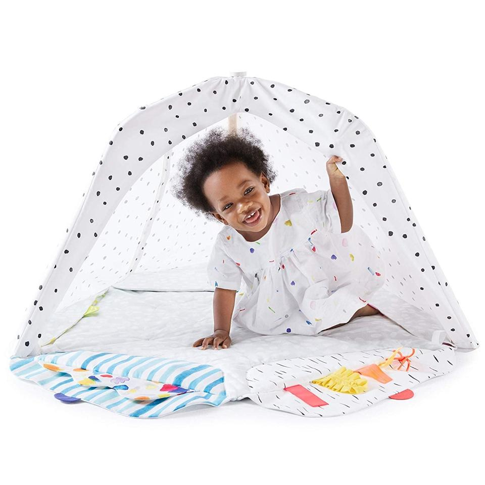 """<p><span>The Play Gym by Lovevery</span> ($134) is a purposeful playmat with five different developmental zones, or flaps, at each edge. Each one offers an array of essentials for each of your baby's learning stages, providing for what they want to see, touch, and explore as they grow. When our senior editor had a chance to <a href=""""https://www.popsugar.com/family/Best-Baby-Play-Gym-44200458"""" class=""""link rapid-noclick-resp"""" rel=""""nofollow noopener"""" target=""""_blank"""" data-ylk=""""slk:review the Lovevery Play Gym"""">review the Lovevery Play Gym</a>, she loved how it encouraged her baby to learn without overstimulating her.</p>"""