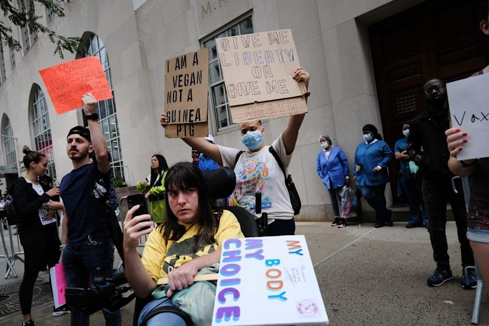 """<div class=""""inline-image__caption""""><p>A small group gathered outside of New York-Presbyterian Hospital on Sept. 1 to protest the mandate for hospital staff to be vaccinated.</p></div> <div class=""""inline-image__credit"""">Spencer Platt/Getty</div>"""