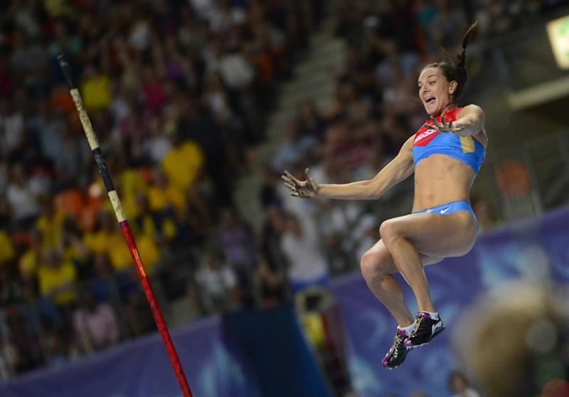 Russia's Yelena Isinbayeva celebrates as she clears the bar during the women's pole vault final at the 2013 IAAF World Championships at the Luzhniki stadium in Moscow on August 13, 2013
