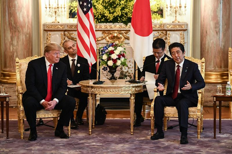 Trump and Abe have forged a close diplomatic relationship (AFP Photo/Brendan SMIALOWSKI)