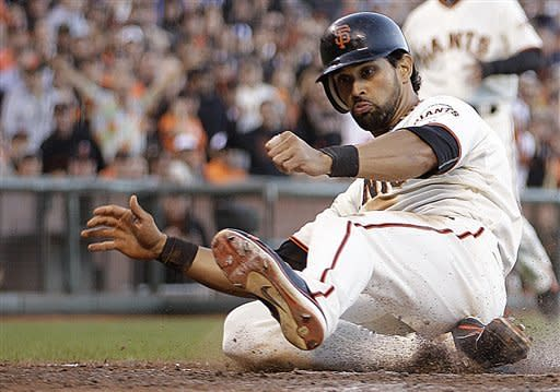 San Francisco Giants' Angel Pagan slides to score against the Los Angeles Dodgers in the fifth inning of a baseball game, Sunday, Sept 9, 2012, in San Francisco. Pagan scored on a sacrifice fly hit by Giants' Marco Scutaro. (AP Photo/Ben Margot)