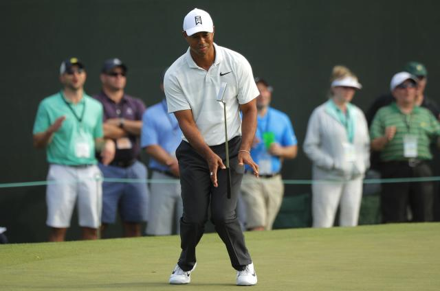 Tiger woods of the U.S. flips his putter after missing a putt on the 14th hole during second round play of the 2018 Masters golf tournament at the Augusta National Golf Club in Augusta, Georgia, U.S., April 6, 2018. REUTERS/Brian Snyder