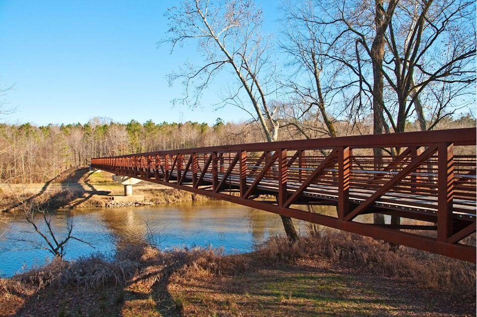 """<p>In Raleigh, you'll revel in a <a href=""""https://www.tripadvisor.com/Attraction_Review-g49463-d4371266-Reviews-Neuse_River_Trail-Raleigh_North_Carolina.html"""" rel=""""nofollow noopener"""" target=""""_blank"""" data-ylk=""""slk:27.5-mile system of paved trails"""" class=""""link rapid-noclick-resp"""">27.5-mile system of paved trails</a> that are friendly to hikers and bikers alike. Along the way, you'll cross several charming bridges and travel through the North Carolina countryside.</p><p><br><a class=""""link rapid-noclick-resp"""" href=""""https://go.redirectingat.com?id=74968X1596630&url=https%3A%2F%2Fwww.tripadvisor.com%2FAttraction_Review-g49463-d4371266-Reviews-Neuse_River_Trail-Raleigh_North_Carolina.html&sref=https%3A%2F%2Fwww.countryliving.com%2Flife%2Ftravel%2Fg24487731%2Fbest-hikes-in-the-us%2F"""" rel=""""nofollow noopener"""" target=""""_blank"""" data-ylk=""""slk:PLAN YOUR HIKE"""">PLAN YOUR HIKE</a></p>"""