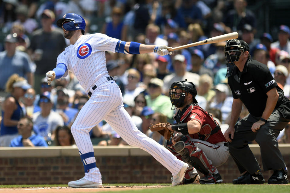Chicago Cubs' Kris Bryant watches his two-run home run during the first inning of a baseball game against the Arizona Diamondbacks Sunday, July 25, 2021, in Chicago. (AP Photo/Paul Beaty)