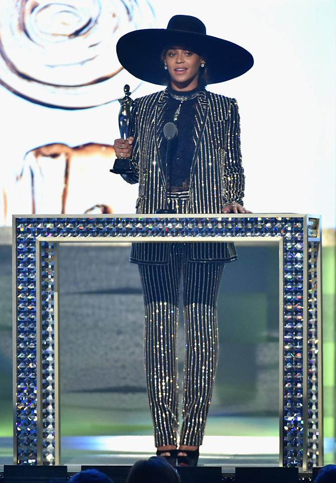 "<p>To accept the CFDA's Fashion Icon Award, Beyoncé, taking a break from Formation World Tour, wore a sequin-striped suit from Givenchy with an oversized wide-brimmed hat. With Jay Z, Blue Ivy, and Tina Knowles in the audience, the <i>Lemonde </i>artist delivered an incredibly powerful speech. ""We have an opportunity to contribute to a society where any girl can look at a billboard or magazine cover and see her own reflection. Soul has no color. no shape, no form,"" she said. ""Just like all your work it goes so far beyond what the eyes can see. You have the power to change perception, to inspire and empower, to show people how to embrace their complications and flaws and see the true beauty that's inside all of us."" <i>(Photo: Getty Images)</i></p>"