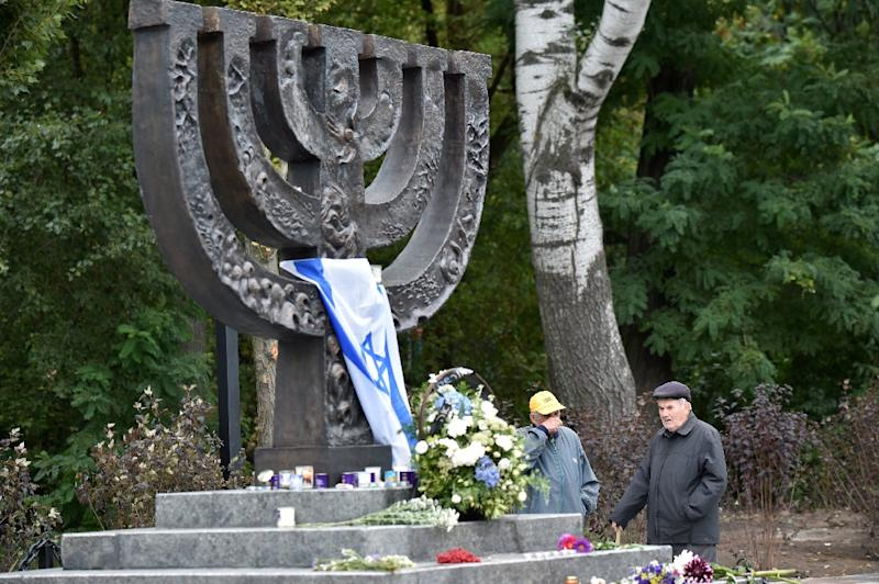 Today Babi Yar, where Nazis helped by local auxiliaries exterminated some 34,000 Jews in 1941, is a green ravine scattered with Soviet-era monuments and a Jewish Menorah (AFP Photo/Sergei Supinsky                 )