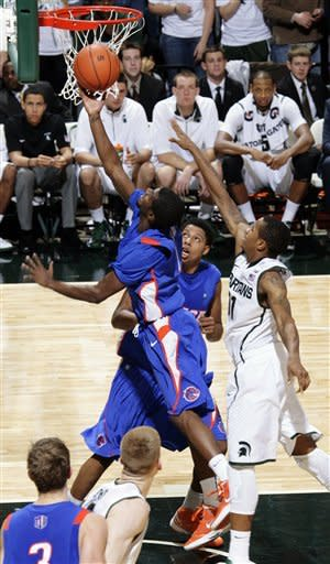 Boise State's Mikey Thompson, left, shoots against Michigan State's Keith Appling, right, during the first half of an NCAA college basketball game, Tuesday, Nov. 20, 2012, in East Lansing, Mich. (AP Photo/Al Goldis)