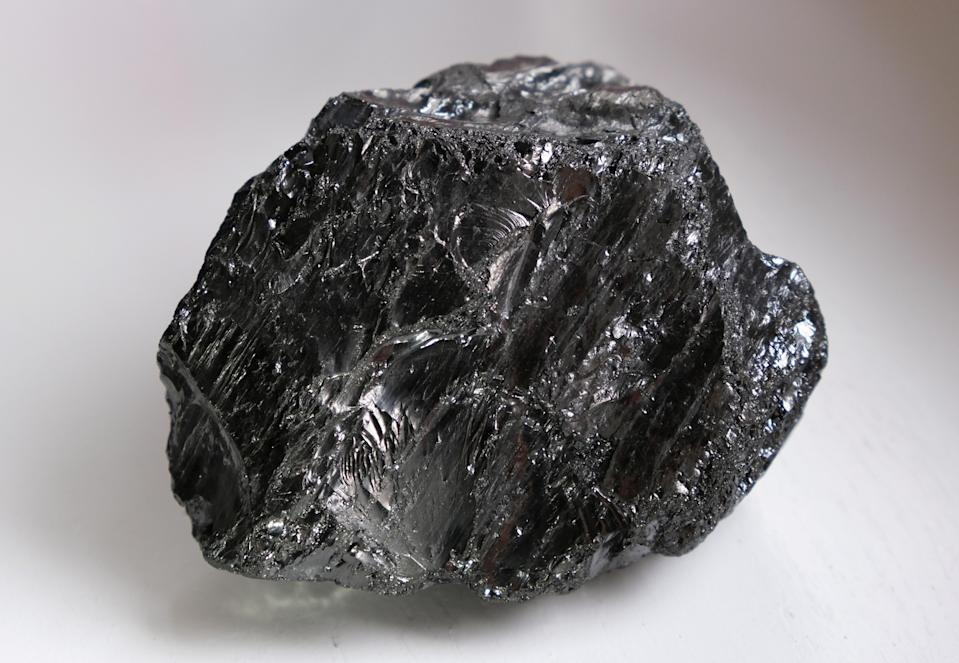 "FILE PHOTO: A piece of anthracite stone coal the size of a tennis ball, extracted from Germany's second last coal mine ""Von Oeynhausen"" in Ibbenbueren of the RAG foundation"