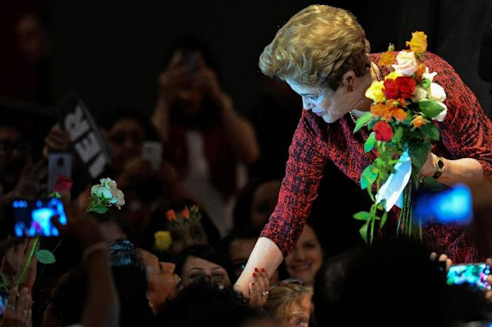 Brazil's suspended president Dilma Rousseff is accused of taking illegal loans to bridge budget gaps during her 2014 reelection (AFP Photo/Andressa Anholete)