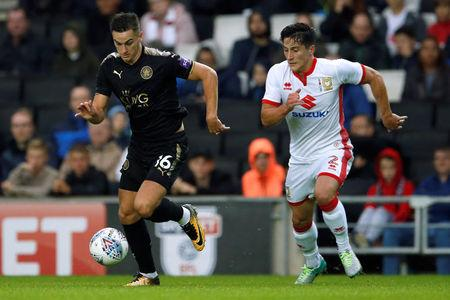 Soccer Football - Milton Keynes Dons vs Leicester City - Pre Season Friendly - Milton Keynes, Britain - July 28, 2017   MK Don's George Williams in action with Leicester City's Tom Lawrence   Action Images via Reuters/Andrew Boyers