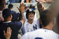 New York Yankees' Andrew Velazquez celebrates after hitting a solo home run in the eighth inning of a baseball game against the Minnesota Twins, Saturday, Aug. 21, 2021, in New York. (AP Photo/Mary Altaffer)