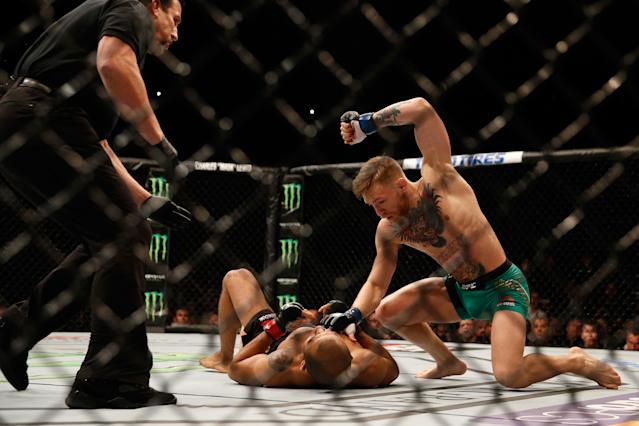 """<p>This was McGregor at his absolute best. McGregor and Aldo had done a lengthy press tour prior to a planned fight five months earlier at UFC 189, but Aldo was injured and the bout was postponed. There was plenty of bad blood between them and McGregor used that to his advantage. This was the debut of """"Mystic Mac,"""" where three days before the fight, he forecast exactly what would occur. Aldo charged him at the opening bell and threw a wild punch. McGregor countered, landed it on the chin and knocked the legendary Aldo out in 13 seconds. </p>"""
