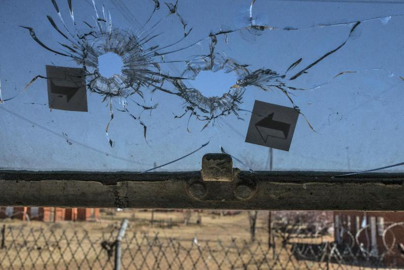 Bullet holes are seen on a window at the Hamabote police station in Maseru on September 2, 2014 a few days after it was attacked (AFP Photo/Mujahid Safodien)