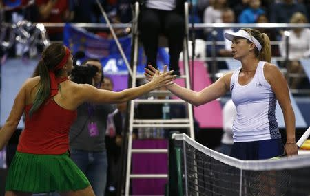 Tennis - Fed Cup Final - Belarus v United States - rubber 3 - Chizhovka Arena, Minsk, Belarus, November 12, 2017 - Aryna Sabalenka of Belarus and Coco Vandeweghe of the U.S. thank each other after the game. REUTERS/Vasily Fedosenko