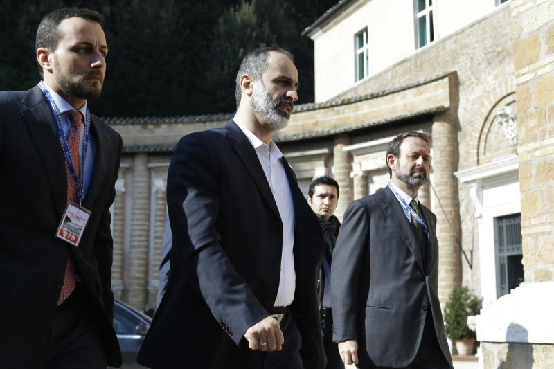 Syrian National Coalition President Mouaz al-Khatib, second from left, arrives for meetings at Villa Madama in Rome on Thursday, Feb. 28, 2013. (AP Photo/Jacquelyn Martin, Pool)
