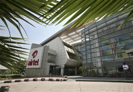 An employee stands in front of the Bharti Airtel zonal office building in the northern Indian city of Chandigarh