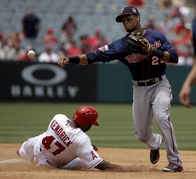 Los Angeles Angels' Howie Kendrick, letf, is forced out at second by Minnesota Twins shortstop Pedro Florimon after Hank Conger hit into a double play during the third inning of a baseball game in Anaheim, Calif., Thursday, June 26, 2014. (AP Photo/Chris Carlson)