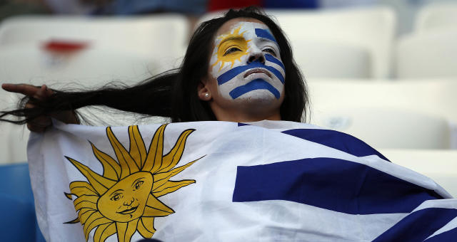 A soccer fan sits on the tribune ahead of the group A match between Uruguay and Russia at the 2018 soccer World Cup at the Samara Arena in Samara, Russia, Monday, June 25, 2018. (AP Photo/Hassan Ammar)