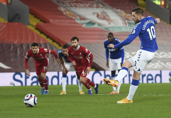 Everton's Gylfi Sigurdsson scores his sides 2nd goal from the penalty spot during the English Premier League soccer match between Liverpool and Everton at Anfield in Liverpool, England, Saturday, Feb. 20, 2021. (Lawrence Griffiths/ Pool via AP)
