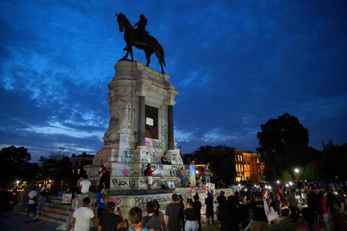 People gather around the Robert E. Lee statue on Monument Avenue in Richmond, Virginia, on June 4, 2020 amid protests over the death of George Floyd in police custody. / Credit: RYAN M. KELLY