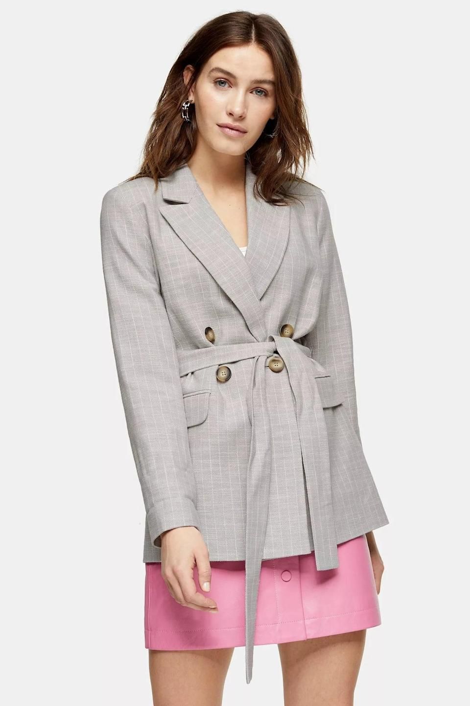 <p>This <span>Gray Belted Double Breasted Suit Blazer</span> ($77, originally $110) sure makes a classy business outfit.</p>