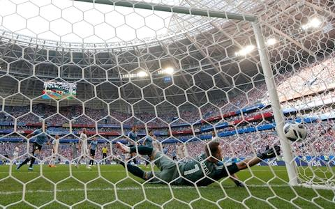 Igor Akinfeev of Russia dives but is beaten by a shot from Diego Laxalt of Uruguay (not pictured) for the second goal during the 2018 FIFA World Cup Russia group A match between Uruguay and Russia at Samara Arena on June 25, 2018 in Samara, Russia - Credit: Getty Images