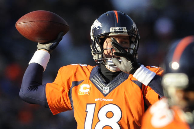 Denver Broncos quarterback Peyton Manning throws against the Tennessee Titans during the first half of an NFL football game on Sunday, Dec. 8, 2013, in Denver. (AP Photo/Chris Schneider)