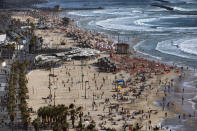 People enjoy the beach front in Tel Aviv, Israel, Saturday, May 22, 2021. A cease-fire took effect early Friday after 11 days of heavy fighting between Israel and Gaza's militant Hamas rulers that was ignited by protests and clashes in Jerusalem. (AP Photo/Oded Balilty)