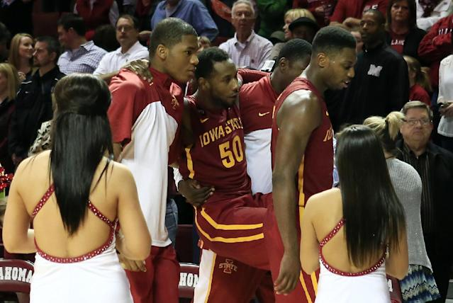 Iowa State guard DeAndre Kane is carried off the floor due to an injury following a loss to Oklahoma in an NCAA college basketball game in Norman, Okla., on Saturday, Jan. 11, 2014. Oklahoma won 87-82. (AP Photo/Alonzo Adams)