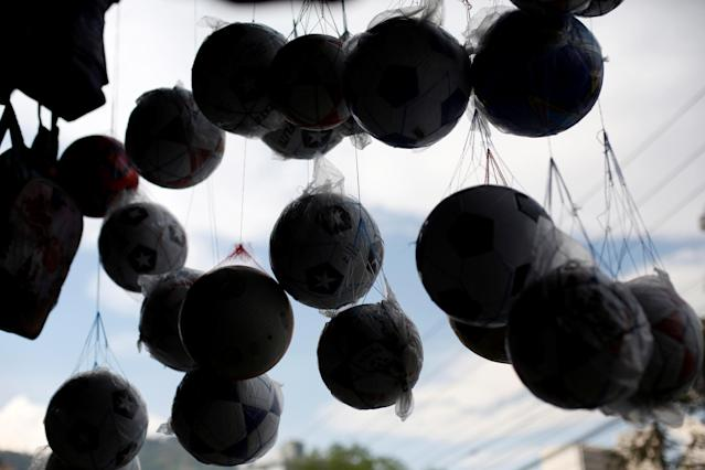 Soccer ball are displayed for sale at an open air market in Tegucigalpa, Honduras May 19, 2018. REUTERS/Jorge Cabrera