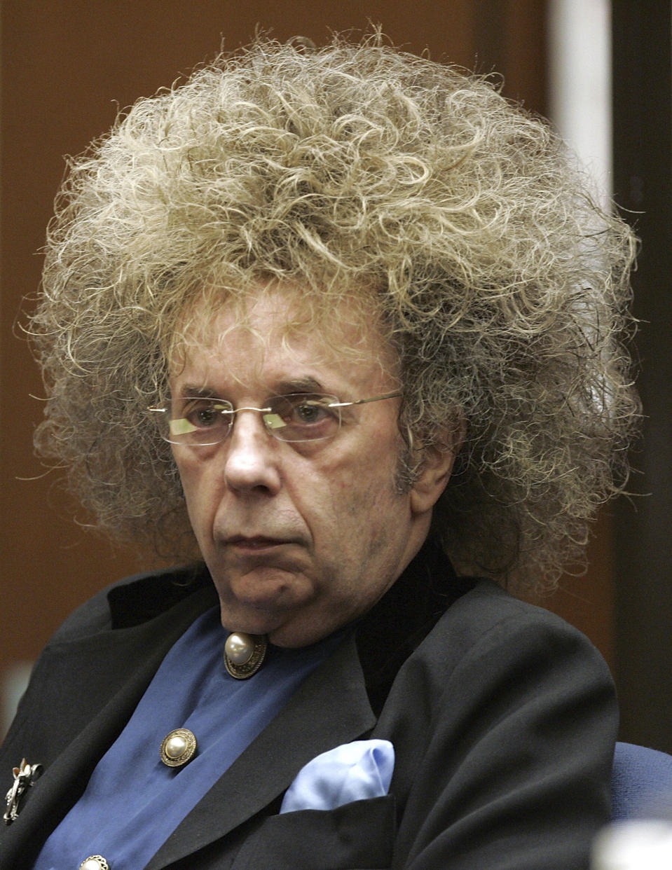 "FILE - In this May 23, 2005 file photo music producer Phil Spector appears during his trial at the Los Angeles Superior Court in Los Angeles. Spector, the eccentric and revolutionary music producer who transformed rock music with his ""Wall of Sound"" method and who was later convicted of murder, died Saturday, Jan. 16, 2021, at age 81. (AP Photo/Damian Dovarganes, File)"