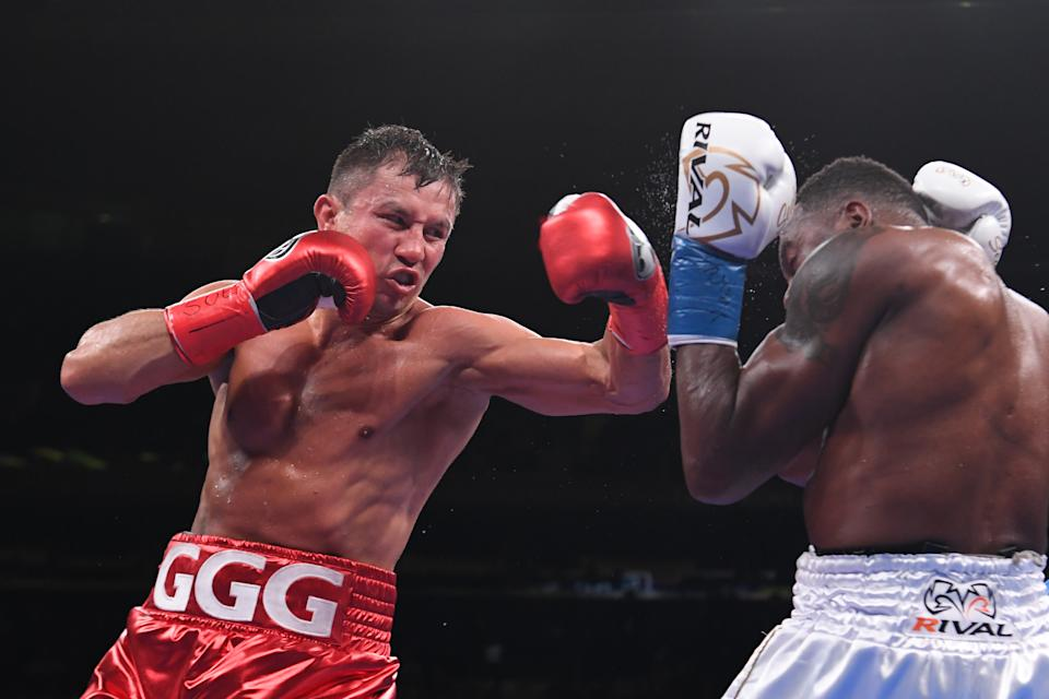NEW YORK, NEW YORK - JUNE 08: Gennady Golovkin of Kazakhstan (red trunks) trades punches with Steve Rolls of Canada (white trunks) during their Super Middleweights fight at Madison Square Garden on June 08, 2019 in New York City. (Photo by Sarah Stier/Getty Images)