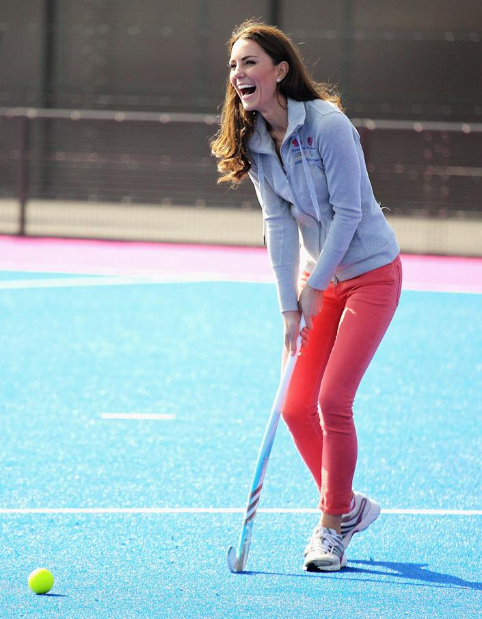 Britain's Duchess of Cambridge laughs as she plays hockey with the British Olympic hockey teams at the Riverside Arena in the Olympic Park, London, Thursday March 15, 2012. The Duchess of Cambridge viewed the Olympic Park and met members of the men's and women's British hockey teams. (AP Photo/Chris Jackson, Pool)