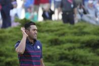 Team USA's Tony Finau reacts after winning a four-ball match the Ryder Cup at the Whistling Straits Golf Course Friday, Sept. 24, 2021, in Sheboygan, Wis. (AP Photo/Jeff Roberson)
