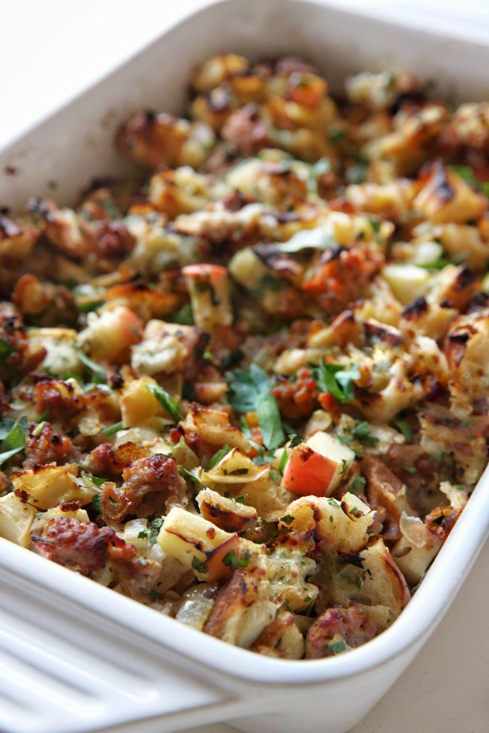 """<p>Apples lend sweetness to this herb-flecked stuffing made with chewy focaccia bread.</p><p>Get the recipe from <a href=""""https://www.delish.com/cooking/recipe-ideas/recipes/a50180/apple-sausage-focaccia-stuffing-recipe/"""" rel=""""nofollow noopener"""" target=""""_blank"""" data-ylk=""""slk:Delish"""" class=""""link rapid-noclick-resp"""">Delish</a>.</p>"""