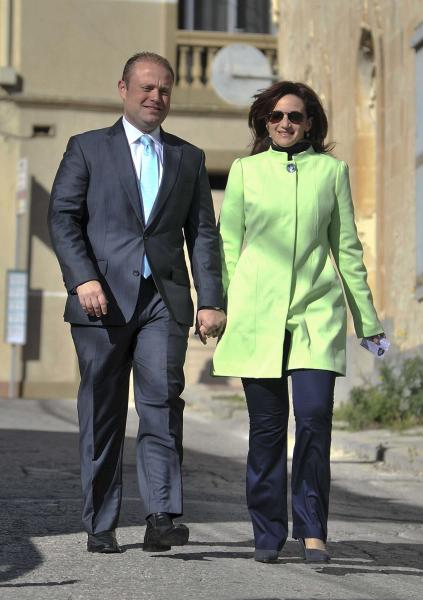 Maltese Labour Party leader Joseph Muscat and his wife Michelle walk to the polling station, in Valletta, Malta, Saturday, March 9, 2013. Maltese head to the polls Saturday to decide whether to grant the center-right Nationalist Party a fourth straight term or give the opposition a shot at government after 15 years. (AP Photo/Lino Arrigo Azzopardi)
