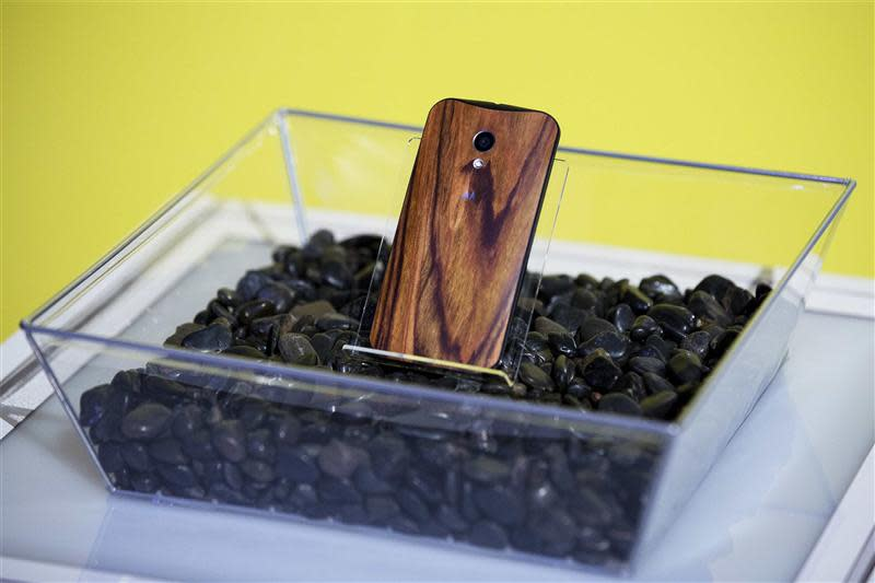 File photo of a phone with a wooden back resting in a display at a launch event for Motorola's new Moto X phone in New York