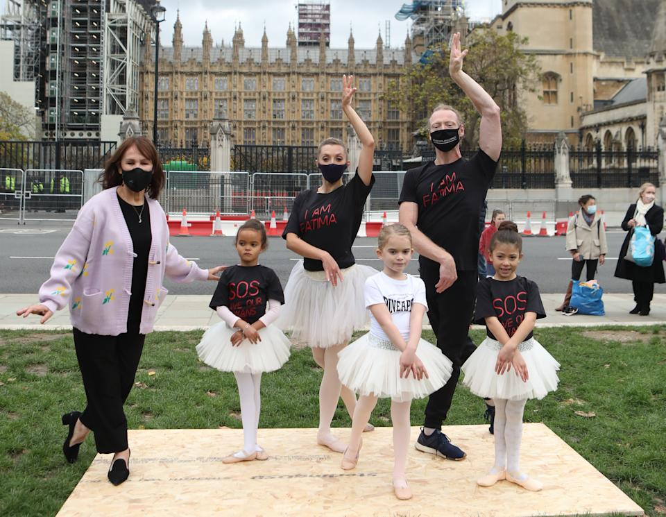 Arlene Phillips (left) joins in with a group of dancers as they perform during a protest calling for more funding for the performing arts in Parliament Square, London.