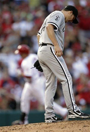 Chicago White Sox starting pitcher Jake Peavy kicks at the mound, while St. Louis Cardinals' Carlos Beltran circles the bases on a solo home run in the third inning of a baseball game, Wednesday, June 13, 2012, in St. Louis.(AP Photo/Tom Gannam)