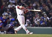 Oct 23, 2018; Boston, MA, USA; Boston Red Sox outfielder Andrew Benintendi hits a double against the Los Angeles Dodgers in the seventh inning in game one of the 2018 World Series at Fenway Park. Bob DeChiara-USA TODAY Sports