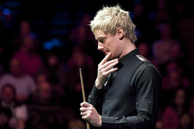 Neil Robertson of Australia looks towards the table while playing against Mark Williams of Wales during a quarter-final match in the BGC Masters snooker tournament at Alexandra Palace in north London on January 20, 2012. AFP PHOTO / BEN STANSALL (Photo credit should read BEN STANSALL/AFP/Getty Images)