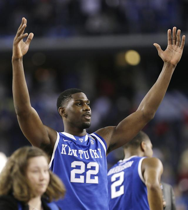 Kentucky forward Alex Poythress celebrates after his team's 74-73 victory over Wisconsin in an NCAA Final Four tournament college basketball semifinal game Saturday, April 5, 2014, in Arlington, Texas. (AP Photo/Charlie Neibergall)
