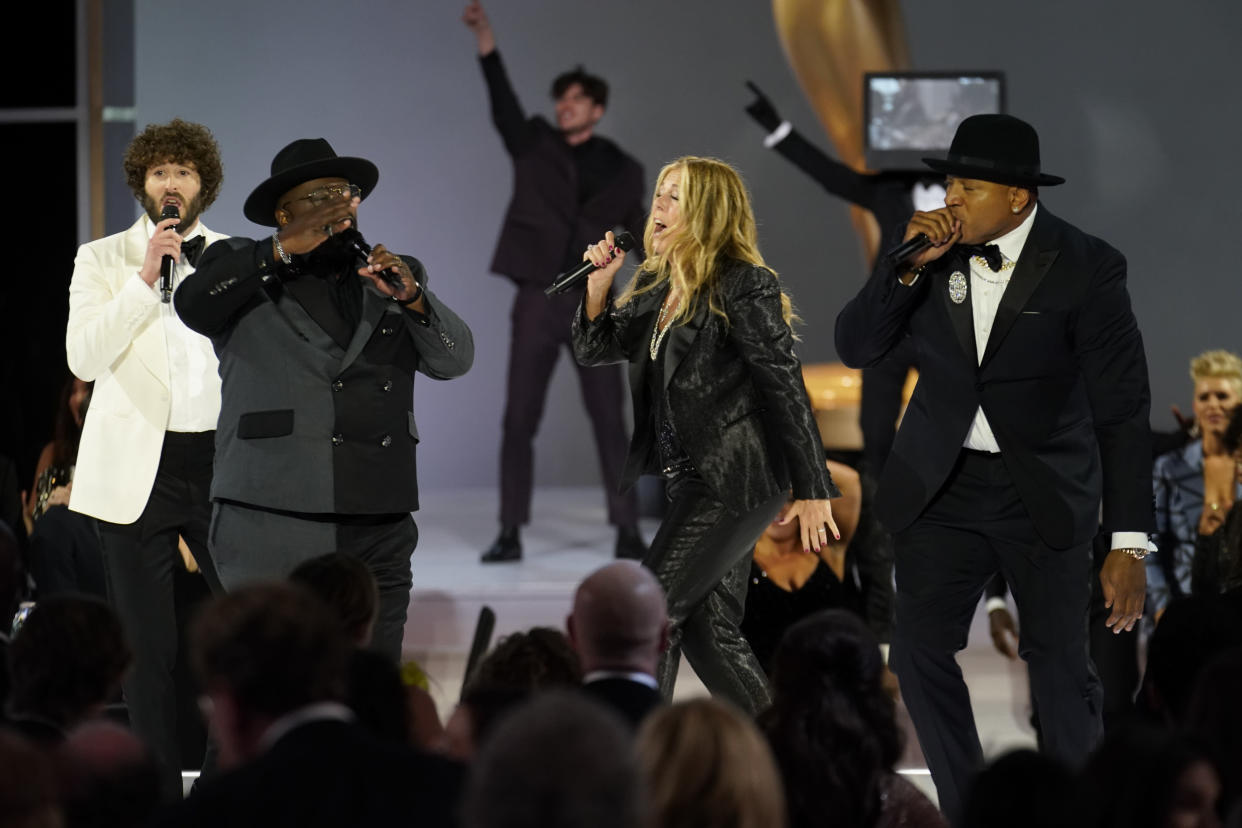 Cedric the Entertainer, Rita Wilson and LL Cool J appear at the 73rd Emmy Awards in Los Angeles.