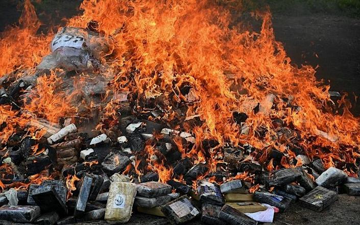 3.3 tonnes of seized cocaine are incinerated at the Military Police of Public Order headquarters in Tegucigalpa, Honduras (AFP/Orlando SIERRA)