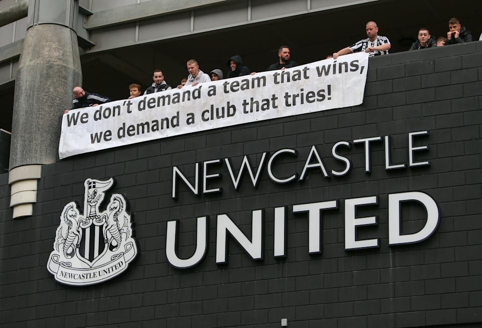 Newcastle United fans (pictured) hold up a protest banner ahead of the proposed takeover Scenes at St. James's Park.